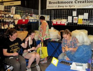 Jill teaching new spinners in our booth!