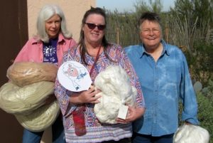 Sue(middle) picking up EASY TO SPIN Cotton supplies from Jill and Lura!